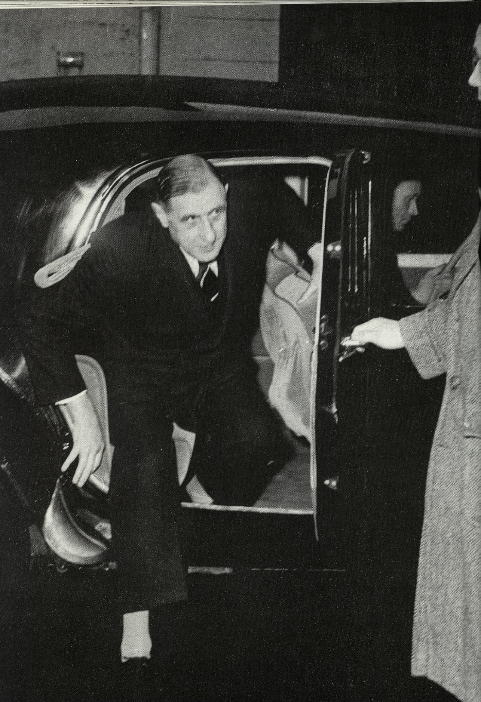 President De Gaulle out of a Citroen Traction Avant